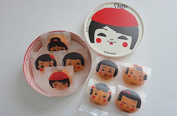 小物入れとしても活用できる丸い箱セットは8個入り。すべて違う表情のこけしのあたまんじゅうが入っています。1個からも購入可能。